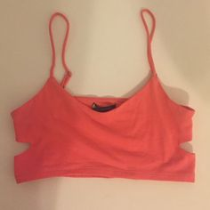 American Eagle bralette American eagle bralette with cut outs on side. Size small. Coral color. *the length is the same as a sports bra, it is a bralette not a cropped top American Eagle Outfitters Intimates & Sleepwear Bras