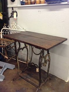 Decorative Iron Base Table with Wood Top - $250