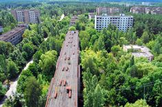 """Pripyat, ghost city abandoned after chernobyl catastrophe, has grown to a forest. nature takes over and invades and collapses human creations the views remind some apocalipthic films like I am a Legend; Views from highst building in town, a former Hotel""."