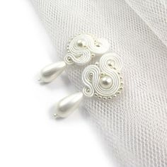 Check out this item in my Etsy shop https://www.etsy.com/listing/464627816/white-wedding-pearls-earrings-stud