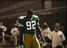 #92 Football Legend In 1993 I captured this unique shot of Reggie White at the Green Bay Packers training camp.  The players were finishing up practice and returning to the locker room.  Green Bay, WI http://deborah-klubertanz.artistwebsites.com/