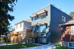 Exterior of Pape Village, a passive and active solar home by Solares Architecture
