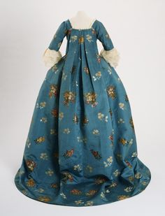 Philadelphia Museum of Art - Collections Object : Woman's Dress (Open Robe à la française and Petticoat) Date: Silk: 1760-1765; Dress: original c. 1760-1765, altered late 1770-1780 Medium: Silk tobine (cannelé) brocaded with colored silks Accession Number: 1955-98-6a,b