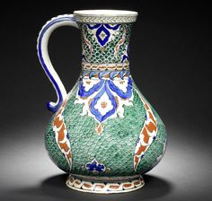 """An Iznik """"Fishscale"""" composite pottery Jug   Turkey, the base circa 1570, the neck with 19th Century French restoration, probably by Samson"""