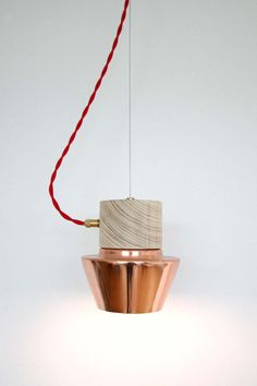Copper lamp with wooden top. Look close, you will notice that all the elements of this design simply join perfectly and give this lamp its honest character