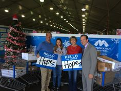 The Hull Family bringing in donations, pictured with our president, Tim Marks in the holiday tent #BeHope