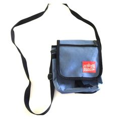 Super handy travel cross body Perfect for sports or travel has 3 compartments , adjustable length cross body strap  lightweight and comfy.  A grayish blue color with black accents Manhattan Portage Bags Crossbody Bags