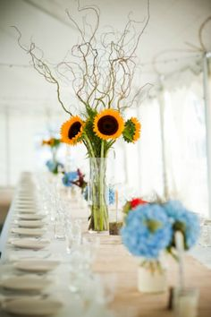 Fleur du Jour - sunflower centerpiece. @Josie Hayes    This would be gorgeous for a centerpiece for the food table!!