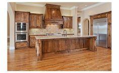 Medium bran cabinetry, stainless, huge island