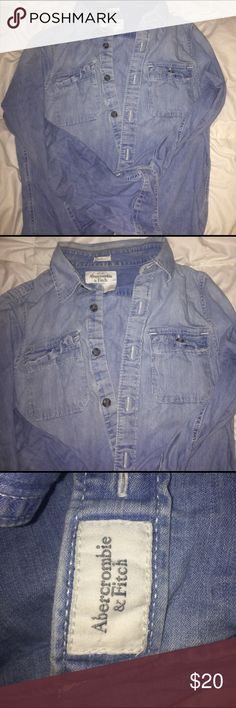 Abercrombie & Fitch Long Sleeve Denim Button Up It's a light blue long sleeve denim button up by Abercrombie it buttons all the way to the collar and on the sleeves and has two pockets on the chest area . Abercrombie & Fitch Shirts Casual Button Down Shirts