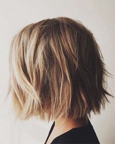 Non-Mom bob cut.  Short with blunt ends.  Messy and lovely.  Something for back to school this fall cut is worth trying.