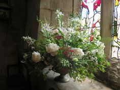 Late June is the perfect time for british grown peonies, and a host of other gorgeous blooms including Ammi Majus, Astrantia, Astilbe and bridal gladioli. Here arranged in an urn for a church wedding.