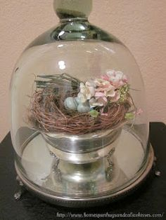 Spring nest in a vintage silver footed bowl ... displayed under a cloche.