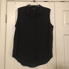 NWOT Black sleeveless top Black sleeve button down top made of 100% polyester. Tags were only taken off to try on but the top has never been worn Mossimo Supply Co. Tops Button Down Shirts