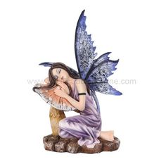 Sleeping Fairy on a Mushroom Figurine is an enchanted piece perfect to display with a centerpiece on an accent table or up on a shelf in the home. Features a go