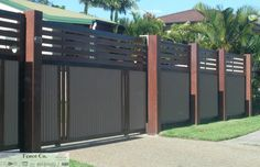 Another custom Colorbond Fence - Eclipse Posts & Rails with Riversand Sheets