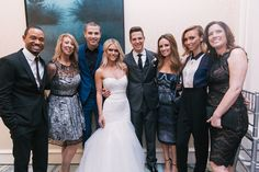 The E! News Crew: http://www.stylemepretty.com/2014/01/22/spot-the-celebrity-wedding-guest-2/
