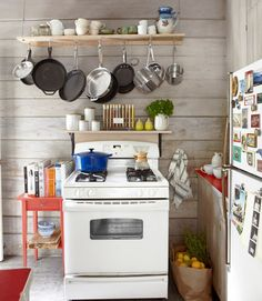Teeny kitchen? Try a custom pot rack like this suspended version.