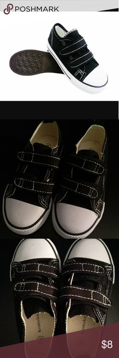 NWOT Black/White Boy/Girl Sneakers NWOT Brand new, never used. I threw out the receipt and box, was unable to return these. Black and white sneakers for the little ones who outgrow their shoes every six months. Koala kids size 8 with velcro closure. Koala Kids Shoes Sneakers