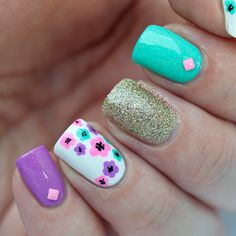 Fun and pretty nails. Flowers and sparkle.