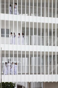 Caged balconies provide open-air corridors that are sheltered from harsh sunlight and tropical rain at this school in Vietnam.