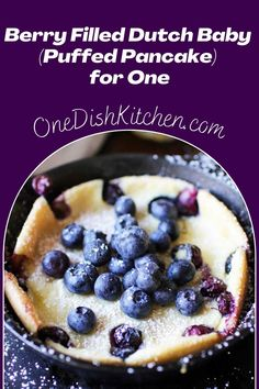 This berry filled Dutch Baby is perfect for breakfast or dessert. Also called a puffed pancake, this single serving treat is a cross between a pancake and a crepe. Filled with sweet berries, it's baked in a mini skillet and can be ready in minutes!