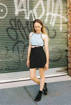 CAVES COLLECT crop top in powder blue and wrap shorts in black linen.