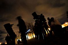 Stars shine at ACC outdoor party-Arapahoe Community College students use large telescopes to peek at Jupiter and three of its moons during a star party hosted by the astronomy department Friday, March 15.