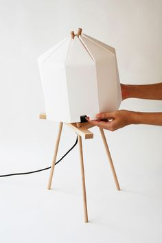 —Paper Lamp is made of bamboo paper covering interlocking wooden supports.