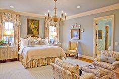Master bedroom and bathroom have a beautiful floral motif that ties both together. Design by Eric Ross Interiors.