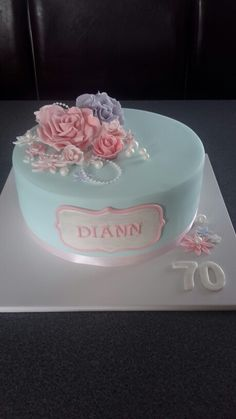 Pretty pastel coloured floral themed cake for a 70th birthday.  Homemade By Hollie.