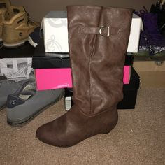 Brown leather knee high boots Medium brown leather knee high boots with gold buckle accent on side and slight wedge heel Body Central Shoes Heeled Boots