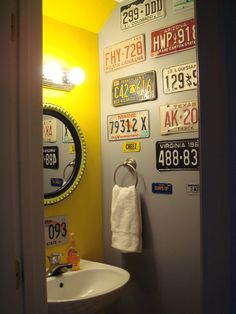 First home - Powder room, entering with view of license plate wall