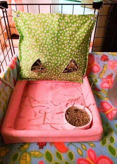 Awesome idea for keeping your chinchilla's kitchen area clean. I'd probably replace the plastic board with a marble board but it would be a great way to stop my chinchillas getting their hay on the fleece.