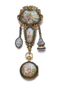 Gold, enamel and diamond watch chatelaine, late 19th century -  The chatelaine of two colour gold foliate scroll design, framing enamel plaques depicting a shepherd and shepherdess, accented with rose diamonds, suspending a seal, locket and fob watch, the circular white enamel dial applied with Roman and Arabic numerals, to rose diamond hands,
