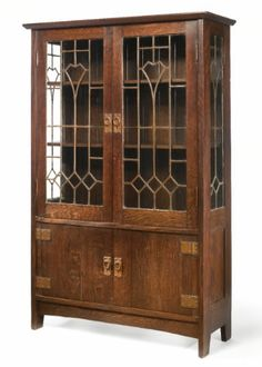 ABOVE IMAGE:  CRAFTSMAN WORKSHOPS CABINET C. 1902 The Stickley Museum's Antique of the Week (12/13/13 - 12/30/13) China Cabinet $242,500.00 AUCTION HOUSE:SOTHEBY'S MAKER:GUSTAV China Cabinet  This elegant Mission piece is attributed to LaMont Warner, one of Gustav Stickley's designers at his Craftsman Workshops. The light Art Nouveau-esque styling of the leaded windows achieve dramatic heights when coupled with the weight of the cabinet's solid oak cabinetry.