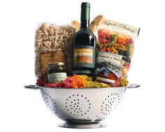Tuscan Trattoria Italian Wine Gift Basket from Tuscany, Italy - Nestled in a colander are ingredients for savory Italian pasta dinners. Rigantoni pasta, marinara sauce, and prosciutto are paired with Banfi Col di Sasso, a Tu. Themed Gift Baskets, Wine Gift Baskets, Raffle Baskets, Fundraiser Baskets, Get Well Gift Baskets, Gift Baskets For Men, Wine Gifts, Food Gifts, Craft Gifts