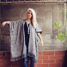 Eco-Friendly Grey Handwoven Blanket Poncho - Hiptipico || Working with artisans in Guatemala, 100% of profits are given to high-need artisans. Fair wage is given to artisans working from family stores, workshops and coops. This fair trade, ethical and sweatshop-free poncho was made without chemicals, and only with plant-based dyes. Perfect for anyone with an adventurous, bohemian style.