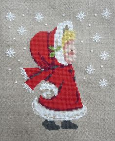 Little blond girl with red riding hood and holly