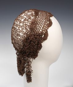 "Cap: ca. 1850, American, hair. ""This headpiece is an elaborate example of the Victorian custom of creating jewelry and other accessories from the hair of loved ones. Designed in the style of a mid-nineteeenth-century snood, this cap approximates a hairstyle of the day. Unusual in its concept, it may have been meant to be worn completely over the wearer's hair or perhaps under a hat."""