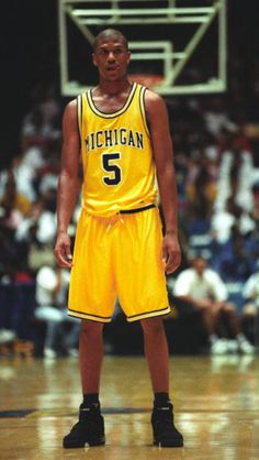 "What made the Wolverines' uniforms from the early 1990s iconic was not just the threads but how the Fab Five wore them: Baggy and with black socks, black shoes, shaved heads and tons of cockiness. UM's beautiful bright yellow unis and the massive block ""M"" on the sides of the shorts have only grown more beautiful with time. http://www.lostlettermen.com/slideshow/photos-top-25-college-basketball-uniforms-ever"