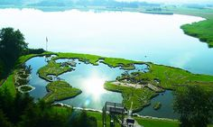 Søren Poulsen built Verdenskortet, a walkable world map made of stones and soil, on top of a pond in Denmark.