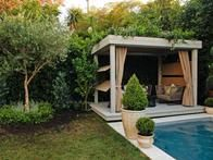Durie also added a breezy gazebo to the foot of Heche's pool. Removing all the bulky outdoor furniture and condensing it into an enclosed space lets the garden take the spotlight.