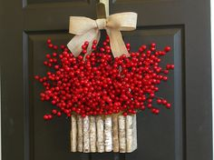 Christmas wreaths Holiday red berry wreaths Seasons Greetings wreaths Christmas front door birch bark vases wreath decorations