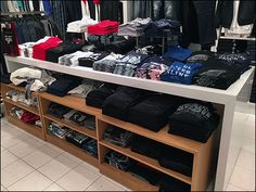 Even a Department Store can take advantage of the mass, universal appeal of T-Shirts. Here space enough is outfitted and configured via Display Table, Trundle Shelf Units, and table-top Pedestals. ...