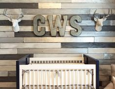 Metallic Wood Wall Nursery - love this modern take on a wood pallet accent wall. So rustic!
