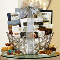 This impressive, interwoven silver metal gift basket is boat shaped and will certainly catch your loved one's eye, but the mouthwatering chocolates and kettle popcorn will definitely tantalize their taste buds this holiday season!