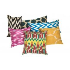 "Our Ikat Pillows are truly one-of-a-kind. Each one features a beautiful silk ikat on the front, but that's where the similarities end. Some are backed in the same fabric, while others are backed in a complementary silk fabric or a crème cotton. Even the zipper applications vary. Isn't it great to have options?    •small: approximately 13""  x 15"" - 21""  •large: approximately 13"" x 18"" - 30""  •silk  •backed in the same fabric, a complementary silk fabric or..."