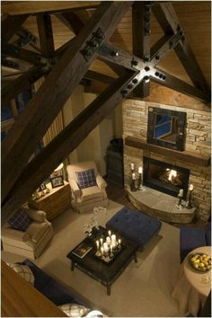 I like the dark beams with the lighter ceiling boards and the cream and blue fabrics.