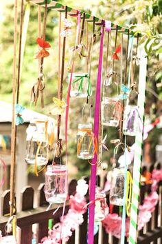hang mason jars with candles around back porch